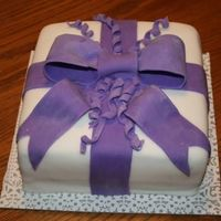 Purple Ribbon This is my first attempt at fondant. Wish it tasted as good as it looks! I think I'm going to really like working with fondant and...