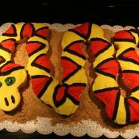 Snake Cupcake Snake cake for an Indiana Jones birthday party. Made of cupcakes. BC icing, graham cracker crumbs for sand. Thanks to all the CC posters...