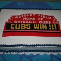 Wrigley Field Marque Birthday cake for a Chicago Cubs fan! White cake with BC icing. Fondant used for the replica of the marque. Had a little trouble with the...
