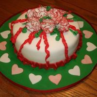 Christmas Is Love This is my Fondant & Gumpaste graduation cake which came just in time for Christmas. White cake, white BC icing and white fondant....