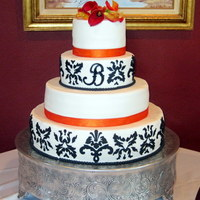 "Damask Cricut Cake 4 tiered cake covered in Satin Ice. designs and ""B"" cut with cricut cake."