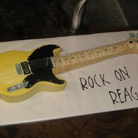 Guitar Look-A-Like I got the inspiration for this cake from my Brother's guitar. Strawberry cake with yellow buttercream the rest is covered with fondant...