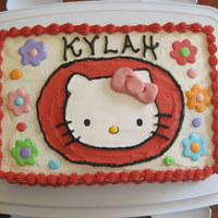 Hello Kitty This is a 9x13 cake frosted with buttercream. The flowers and polka dots and hello kitty face are royal icing dried on wax paper for a few...