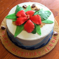 "Tropical Birthday Cake 8"" Lemon cake with huckleberry filling. Frosted in buttercream and decorations in fondant and gumpaste and chocolate shells."
