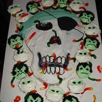 Pirate Skull Cake red velvet cake with bc frosting. vampire and mummy cupcakes. This was a fun cake to do with my kids and they loved putting the gummy worms...