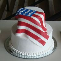 Draped Flag BC icing covered with a fondant flag.