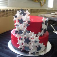 Red Black And White Stars Buttercream frosted with fondant stars. Ideas from other wonderful cakes from this site.