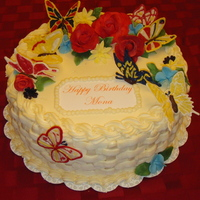 Butterflies And Flowers This is a strawberry cake, flowers are gumpaste/fondant mix and butterflies are candy melts.
