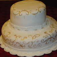 50Th Wedding Anniversary Two tier white almond cake with caramel filling. The cake was topped with a vintage bride and groom but I didn't get a picture of the...