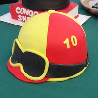 Jockey Helmet Jockey Helmet made to celebrate Steeplechase in Franklin, TN. Cake is chocolate with buttercream and fondant.