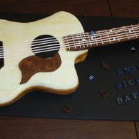 Groom's Guitar Cake The groom played this guitar in a band. It is a yellow cake with buttercream filling. All accents are fondant or gumpaste. The picks are...