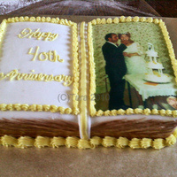 40Th Wedding Anniversary Cake Vanilla cake,Vanilla buttercream for the crumb coat,covered in fodant,Fondant & buttercream decorations.Customer wanted it very simple...