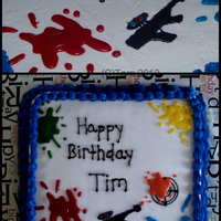 Paintball Birthday Cake Vanilla cake(the inside is marbled in 6 different colors-kind of a tye dye effect), all vanilla buttercream.