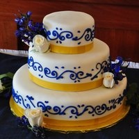 Simple Blue And Gold Wedding Cake blue scroll on white fondant and gold edible ribbon