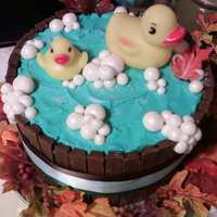 "Ducks In Barrell Tub 4 - 9"" Cakes that are stacked and filled with raspberry mousse (found on CC), and buttercream. Crumbed coated and stuck 1 and half kit..."