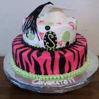 Funky Girly Graduation Cake  The instructions for this cake was only funky and girly, Thanks to the many ppl on here for the posts that gave me inspiration for this...