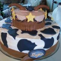 "Cowboy Cake Cake was for a cowboy themed baby shower, covered on "" Crusting Buttercream"" with Wiltons fondant accents."