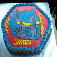 Transformers Cake   Covered in Crusting Buttercream, and filled with it also. SOO much fun to draw and fill in!!