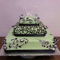 Lime Green & Black Swirls Wedding Cake White cake with MMF covering it. I painted the black swirls with wiltons black gel color. The topper was Wilton fondnat rolled and formed...