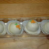 Carrot Cake Balls Carrot cake, cream cheese icing, white chocolate, royal icng decorations