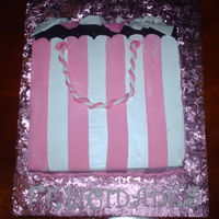 Shopping Bag!   carrot cake,cream cheese filling,pastry pride and fondant accents, TFL all comments are always welcome, have a great day