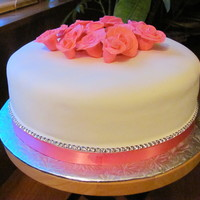 Girlie Cake This is a lemon cake filled with fruit billing, covered with buttercream and fondant. All roses are made out of gumpaste.