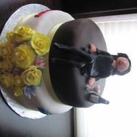 B-Day Cake Chocolate and lemon cake covered w/ buttercream and fondant. Accents and the lady are made out of fondant.