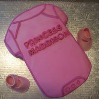 Baby Shower Cake I attended a friend's baby shower on the weekend. I made a babycake shaped as a baby onesie. Flavors are white cake w/ vanilla pudding...