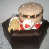 Burger Cake I made a cake with the recipe of a Heinz Ketchup Cake with creamcheese as the icing. All covered in fondant. the burger bun, pattie, french...