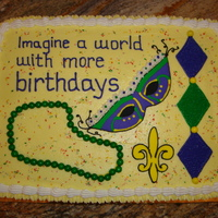 Mardi Gras Cake BC frosting, RI mask made ahead of time and beaded necklace made of Sixlets.