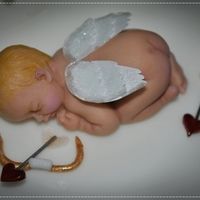 Cupid's Sleeping Another baby made from my First Impressions mold. Made for a Valentine's Day Cake Challenge display table. Everything is edible except...