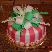 Peppermint Candy Cake Made to look like a peppermint candy, this was for a Christmas Party I went to this weekend. All fondant details with peppermint candies...