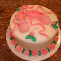 Ballet Slippers   This was a birthday cake for a woman who teaches ballet. Slippers and roses made of fondant.