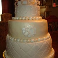 "50Th Wedding Anniversary Cake 50th Wedding Anniversary Cake made for neighbor's parents. 6"", 10"" and 12"" rounds with fondant accents."