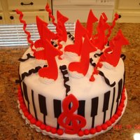 Music Explosion This cake was made for a music-loving birthday girl. Chocolate cream cake. All fondant accents.