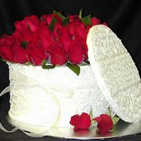 American Beauty Montagne Noire Chocolate cake. iced in Toba Garret's French vanilla butter cream. Natural roses
