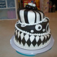 Wonky/topsy-Turvy/mad Hatter Cake - 2009-02-08 I saw this cake on this site and couldn't resist! I just HAD to try my hand at it!This was for my so's 16th Birthday Party....