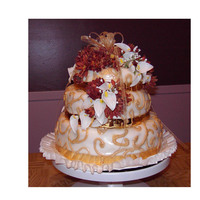 Fall Wedding Cake The cake is a traditional Tridadian Fruit cake.... very heavy! The flowers are silk.