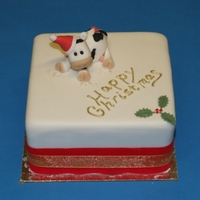 Cow Christmas Cake Mini-fruit cake covered in fondant with cow wearing santa hat, made from sugar paste