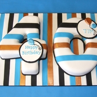 Striped 40Th Birthday Cake Fondant covered forty cake covered with stripes, some of which are painted with lustre-dust.Pastillage plaques and run-out royal iced...
