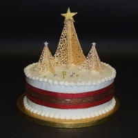 Christmas Cake With Royal Icing Royal-Iced fruit cake with trees from royal icing and fondant stars