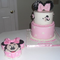 Minnie Mouse Cake & Smash Cake I just love this cake. The little minnie faces on the top tier of the main cake was a challenge to make out of fondant, but I am happy with...