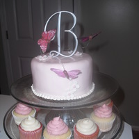 Butterfly Cake & Cupcakes This cake was made for a couple that had a destination wedding, but wanted to celebrate with family once they returned home. The top tier...