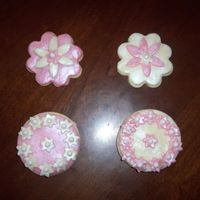 Prettycookies.jpg   These are NFSC covered in White Chocolate Modeling clay then dusted with Luster dust!
