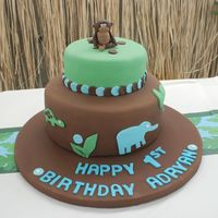 "Jungle Themed Birthday Cake  This cake was inspired by Alexander Henry's beautiful ""zoo"" fabric. The monkey took entirely too long to do. I need to get..."