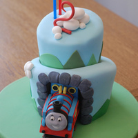 Thomas The Tank Engine Cake Chocolate cake with vanilla SMBC, covered in fondant. My first attempt at a topsy turvy cake. So many things went wrong, so I really have a...
