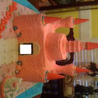 Castle castle is butter-cream icing - turrets are ice cream cones -walkway and door/windows are mmf and tiara is royal icing