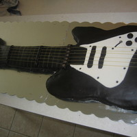 Electric Guitar Cake This is a replica of the guitar my grandson go for his birthdayt. Entirely editable. covered with Duff's black fondnt, and my white MM...