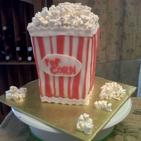 Popcorn Cake - Small This is a strawberry cake, filled with buttercream and iced with fondant. Popcorn made out of mini marshmallows, painted with thinned icing...