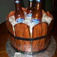 Bucket Of Cold Beer Cake this is the first time I have made this cake... I'm very happy with the way it came out... I got a call from the person this cake was...
